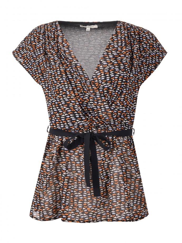 Sleeveless and patterned tunic