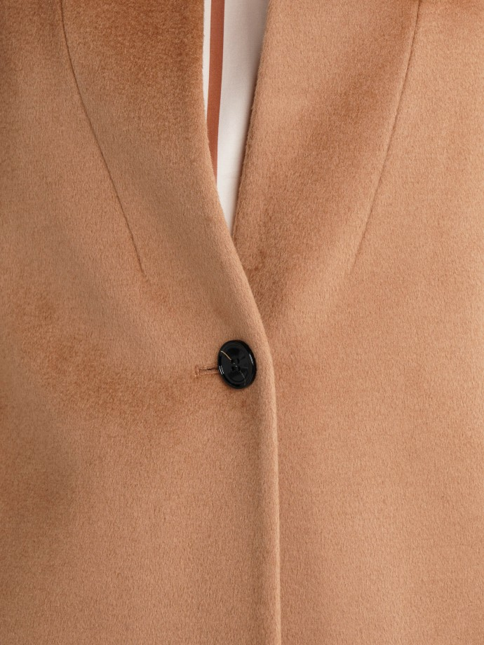 Coat with button